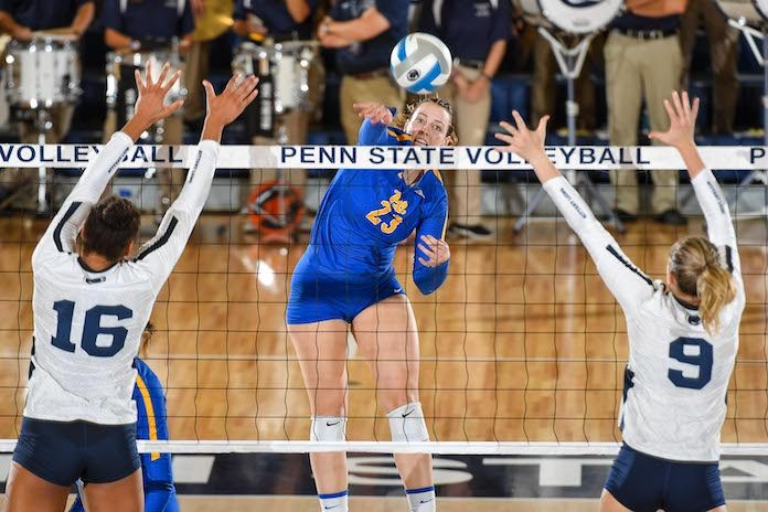 Pittsburgh's Kayla Lund hits between the Penn State block of Serena Gray, left, and Jonni Parker, (Photo by Mark Selders)