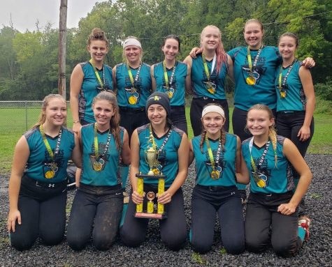 Ellie Coursen (front center) captures a tournament win with her travel softball team.