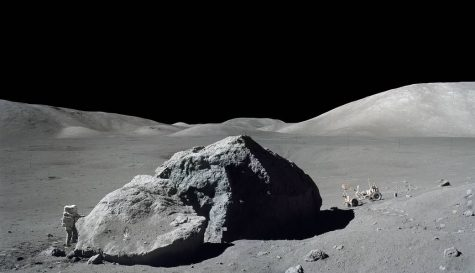 A picture taken on the Apollo 17 mission, showing an astronaut next to a massive boulder found on the moon.