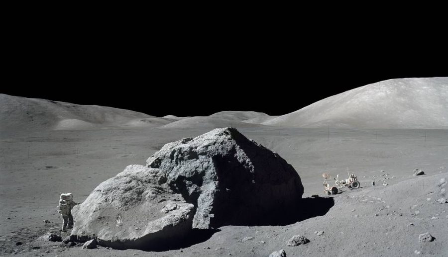 A+picture+taken+on+the+Apollo+17+mission%2C+showing+an+astronaut+next+to+a+massive+boulder+found+on+the+moon.