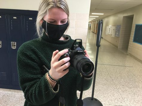 Sammie Snider getting footage ready for her documentary.